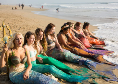 Mermaids resting on the beach